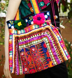 An exclusive range of stylishly designed Jhola Bag similar to shoulder bag. These bags comprised of beautiful antique textiles from Gujarat and Rajasthan. Jhola bags made of Cotton material with thread work elephant, mirror, flower etc different type work in Jhola Bag.