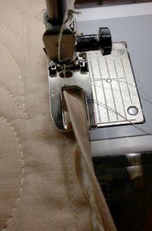 quilt binding using flat fell foot http://awomanaday.com/2013/01/17/happy-feet-quilt-binding-edition/