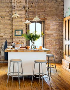 The owner of this Minneapolis farmhouse-style loft made a kitchen island from an old cabinet, which she topped with wooden packing crate slats.