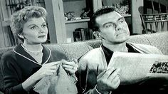 After spending the day taking care of her house, June Cleaver (Barbara Billingsley) sits with Ward and knits