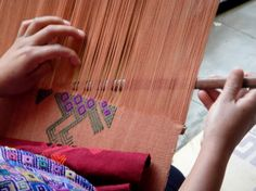 Backstrap loom weaving