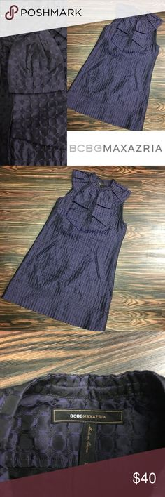 BCBGMAXAZRIA shift w/POCKETS!!! NEVER WORN NEVER WORN!!! Gorgeous detail! Iridescent purple on black with stunning weave on fabric. Buttons on front placket. 61% polyester, 39% acrylic. With POCKETS!!! Size XS. BCBGMaxAzria Dresses