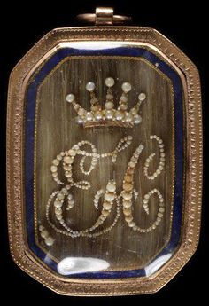 English engraved & enameled gold locket set with seed pearls and hair...circa 1784