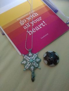 This is what I sent to Natalie. The pendant on the left was a gift. The lampwork bead for her to use for the blog hop is on the right. This is Natalie's photo because I forgot to take a photo before I mailed it.