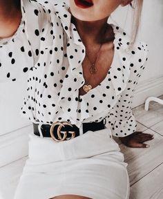Cute black and white ruffled polka dot blouse with white mini skirt.