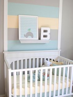 Rather than painting the wall behind the crib one color, why not get creative with paint and go for three or four colors? Horizontal or vertical stripes are super dramatic. Here, Rebecca Propes of Fresh Chick Designs frames the center of the wall with molding and paints the stripes down the middle giving the room an instant focal feature. Photo courtesy of ProjectNursery.com