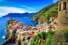 Buy Scenic view of colorful village Vernazza in Cinque Terre by on PhotoDune. Scenic view of colorful village Vernazza and ocean coast in Cinque Terre, Italy Places In Italy, Places To Visit, Cinque Terre Italia, Riomaggiore, Italy Art, Beaux Villages, Italy Tours, Parc National, National Parks