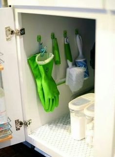 Hang cleaning tools in cabinet