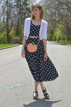 Polka dot midi dress with cut-out details from alittlelau.com