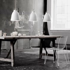 Caravaggio by Fritz Hansen charms with the elegance of dark grey, matt-lacquered shade. Designed by Cecilie Manz, Caravaggio lamp features a deep shade which prevents glare, and an opening at the top, allowing the light to cast also upwards. Caravaggio, Fritz Hansen, Interior Design Kitchen, Modern Interior, White Pendant Light, White Pendants, White Light, Perriand, Design Bestseller