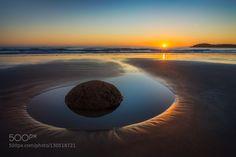 Moerakis Orb by philnormanphoto  beach boulders new zealand newzealand ocean rocks sea sky sun sunrise sunset water moeraki Moeraki's