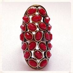 Gorgeous Coral And Gold Tone Ring Very stylish and fun statement ring by Mark, a fantastic maker of statement costume jewelry. Great quality. Simulated coral and old gold tone one size ring. Fits from a 5-9 ring finger easily. New with box. A definite fun statement ring and well made piece of jewelry. Mark Jewelry Rings