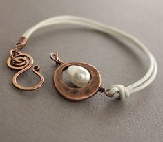 White leather copper bracelet with white Swarovski by IngoDesign. I love the simplicity of this piece.