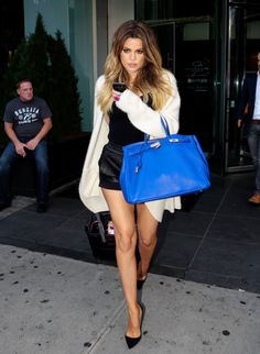 Khloe Kardashian street style with cardigan, leather shorts and Hermes handbag