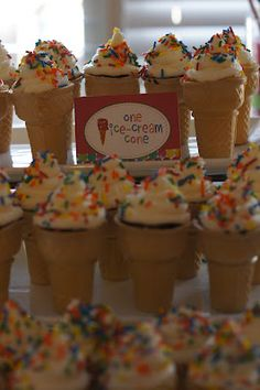 "Food for ""The Very Hungry Caterpillar"" party:  These are cupcakes baked in ice cream cones.  I wonder if pudding would work in there as well?"