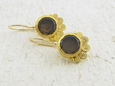 Handmade gold earrings. Brown Smoky Topaz wrapped with 24k solid gold combined with 22k solid gold punched spirals and dots.    The back is made 9k solid