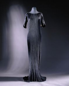 Delphos dress Collection Victoria & Albert Museum  Artist/Maker Fortuny, Mariano (designer) Date ca. 1920 (made) Place Venice (made) Materials & techniques Pleated satin Source Given by Mrs Hollond