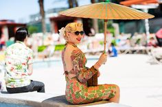 This is just super fantastic. In every way. Print and cut of the dress are awesome, goes great with her tattoos, the makeup, hair, glasses, umbrella.... love it    On the Scene…..Pool Party at Viva Las Vegas, Las Vegas « The Sartorialist