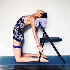 Ustrasana. More stable if chair is placed against wall.