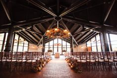 Lake Geneva Wedding | Grand Geneva Wedding | Ski Chalet Wedding | Fall Wedding Mountain Top Chalet ceremony decorations, floral chandelier, lanterns as an aisle decoration floral by Frontier Flowers of Fontana photo copyright m three studio