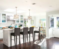 Cottage Kitchen, dark floors, white walls and touches of blue
