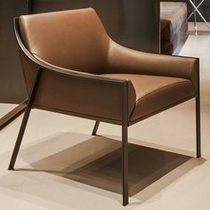 Contemporary armchair / leather / chrome steel / by Christophe Pillet AILERON L Frag