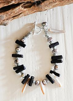 Black wood, shell & freshwater pearl bracelet. Hand-made with fair trade principles in Zambia, selling in London and at https://www.facebook.com/kuducollection
