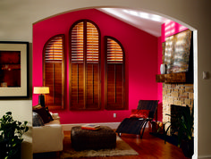 Unique arched wood shutters from Budget Blinds.