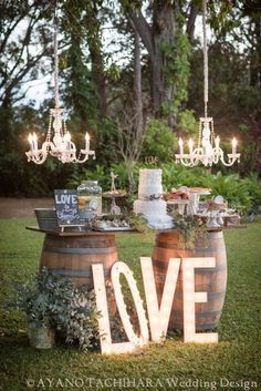 Hang one or two chandeliers over a dessert table to make it a true highlight at your wedding reception!
