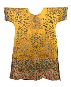 A yellow silk brocade 'dragon' robe, probably 19th century, with the twelve symbols of imperial sovereignty comprising the sun, moon, constellations, mountains, the axe head, fu symbol, fire, grain, seaweed, dragons and pheasants all stitched in as later additions and with further alterations to the robe, with gold wire dragons interspersed with bats and ruyi clouds