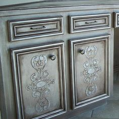 Stencil embossed cabinetry accented with Modern Masters Metallic Paint   by Joy Matheson of Scribbles Murals
