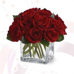 Centerpiece of one dozen red roses in square vase.
