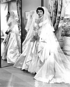 "Elizabeth Taylor in ""Father of the Bride"" (1950).  The dress was designed by Helen Rose, who also designed Elizabeth's real-life wedding dress for her wedding to Nicky Hilton.  The real-life wedding also took place in 1950, when Elizabeth was 18 years old."