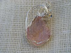 Pink Andara crystal wrapped in German silver