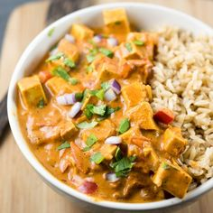 Tofu tikka masala made vegetarian and vegan using coconut milk! Add to the slow cooker, set and forget! Gluten-free recipe with authentic flavors.