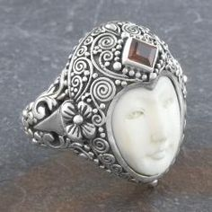 @Overstock - This beautiful silver garnet room features a lovely silver setting which holds a lovely garnet stone. The Indonesian cow bone face is a striking contrast to the traditional stone setting. This ring is constructed of environmentally conscious materials.http://www.overstock.com/Worldstock-Fair-Trade/Sterling-Silver-Garnet-Moon-Princess-Ring-Indonesia/5506886/product.html?CID=214117 $73.99