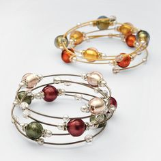 Set of 3 Murano Glass Beads Bracelets ~ Art glass for the wrist. Made in Murano, Italy, world-renowned for its glass-blowing artisans, this trio of spring-wire bangles features glass pearls and Swarovski crystals. The crown jewels of each bracelet are hand-blown Murano glass balls painted on the inside with gold or silver foil finish for slight shimmer.
