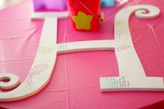 Instead of a guest sign in book, how about a big letter for all your friends to sign and then you can hang it up later, great idea for a sweet 16 or quincenera.