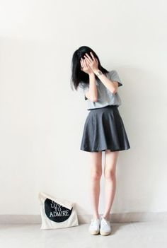 Spring /summer outfit. Boxy grey tshirt, black circle skirt, sneakers