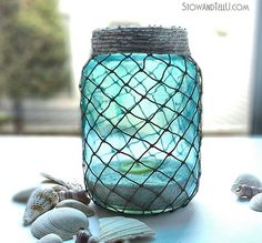 How to wrap jars with decorative fisherman netting for a nautical inspired, coastal look indoors or out.
