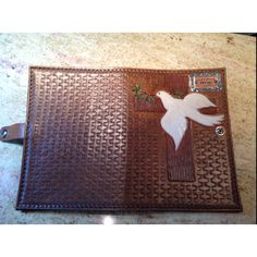 Hand tooled leather bible cover.