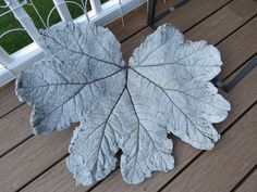 How to Cast a Cement Garden Leaf ~~She used: ~a leaf ~a sand pile ~plastic wrap ~ gloves ~a mask ~cement (PROFINISH BY QUIKRETE BLENDED MASON MIX) ~water ~a bin or something to mix your cement in ~~It takes about 2 days to cure.