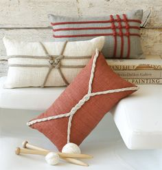 These are store-bought pillows with knitted cord tied to them. But I can see using the one at upper right (woven weave pillow) as a package decoration. The link has diagrams for tying the lines.     Of course, learning to knit the I-cords would be good, too.