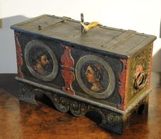 .Very rare Renaissance iron box with original key and complicated locking mechanism. Painted on all sides, with portrait medallions of Roman emperors wearing laurel wreaths. Paint is remarkably well preserved. German, 17th century.