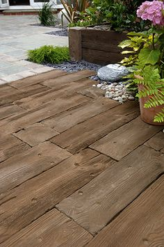 Woodstone Sleepers - Realistic looking woodstone sleepers.All the aesthetic advantages of wood plus the durability of concrete. Less maintenance and no wood preservative required.