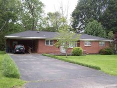 Older brick home with 1744+/- heated square feet. In good condition with central heat & air, den with fireplace, 3 bedrooms, den could be 4th, 1.5 baths, large rooms, hardwood under carpet. On a large level lot. Move in Ready! Great buy for a large family! Can purchase home & extra lot for $79,500 or just lot for $15,000 in Savannah TN