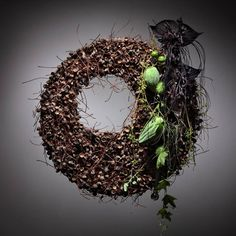 Asymmetric wreath with Acorn caps - via Facebook