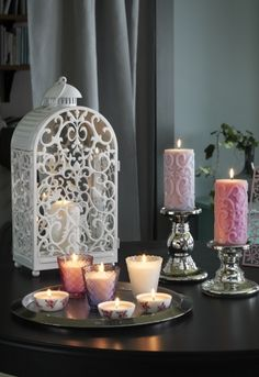 The warm light from a candle shines decoratively through the scroll pattern on IKEA GOTTGÖRA lantern for a bit of old-world style romance on your wedding day.