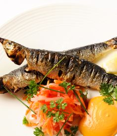 Nathan Outlaw's grilled sardines recipe comes served with smoked paprika mayo and pickled vegetables, giving the classic fish dish a contemporary edge