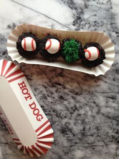 New mini baseball cupcakes at Georgetown Cupcake served in a paper hot dog tray. Dc Cupcakes Recipes, Georgetown Cupcake Recipes, Cookies And Creme Cupcakes, Gourmet Cupcakes, Mini Cookies, Cute Cupcakes, Cookies And Cream, Cupcake Cookies, Baseball Cupcake Cakes